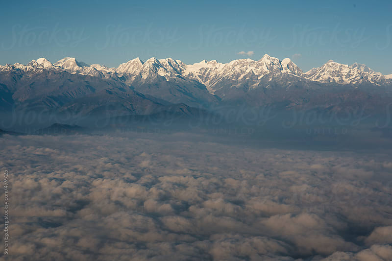Aerial view of clouds and Himalaya mountains from above. by Soren Egeberg for Stocksy United