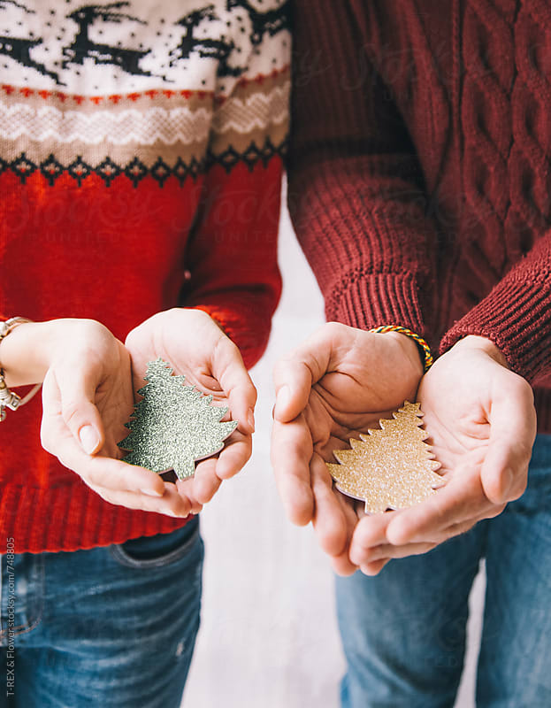 Couple holding handmade fir trees in hands by Danil Nevsky for Stocksy United