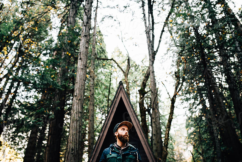Young trendy man with cabin by Isaiah & Taylor Photography for Stocksy United