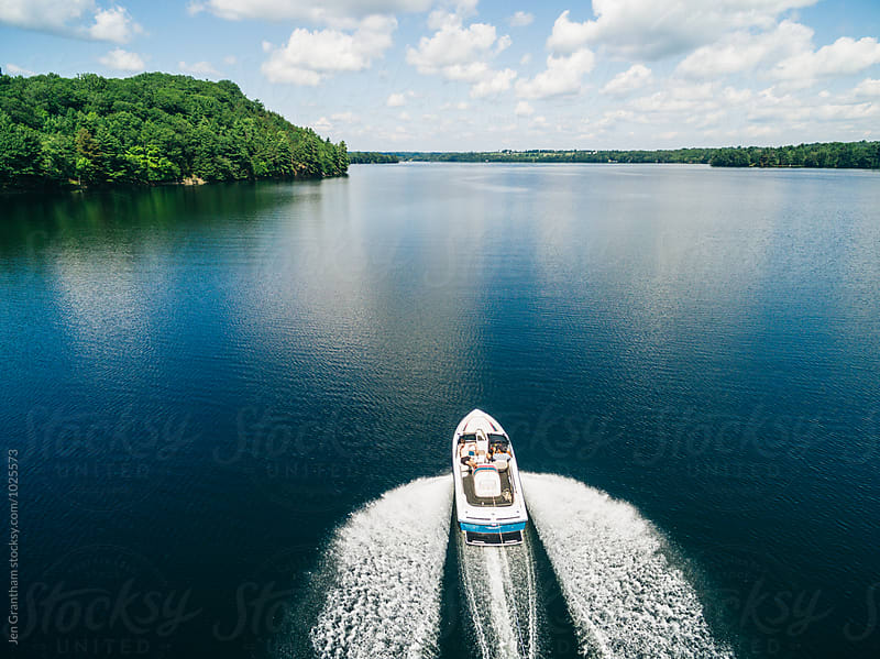 Overhead view of a boat and its wake