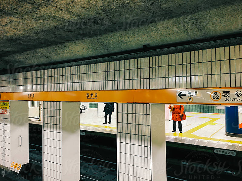 Passengers Waiting for Train in Tokyo Subway by VISUALSPECTRUM for Stocksy United