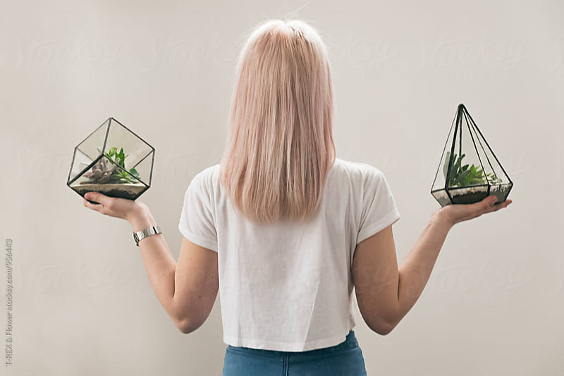 Back view of blonde woman holding hothouses with succulents by Danil Nevsky for Stocksy United