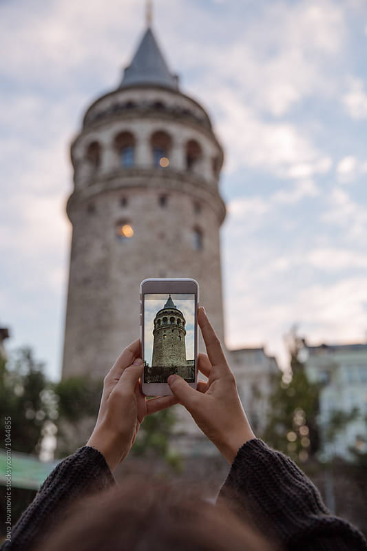 Tourist taking a photo of Galata tower in Istanbul by Jovo Jovanovic for Stocksy United