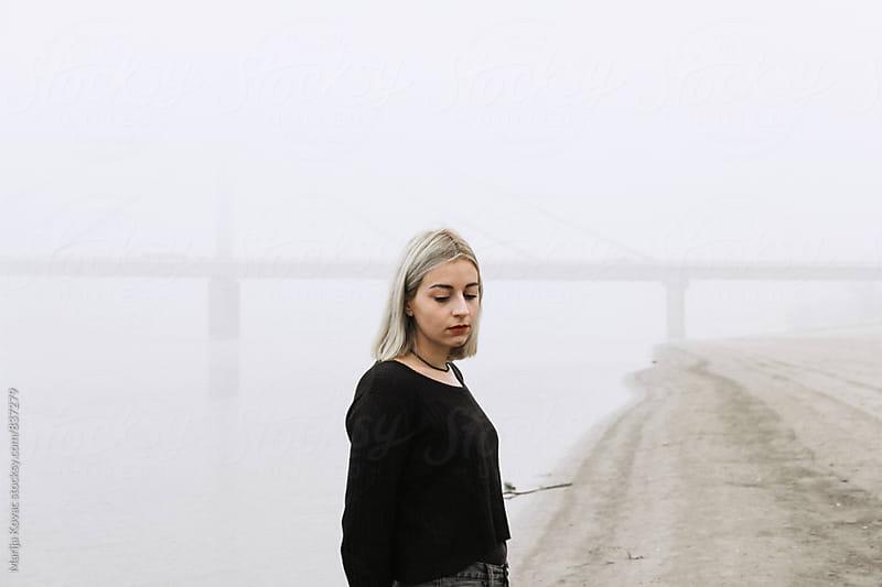 Blonde woman on the beach - horizontal by Marija Kovac for Stocksy United