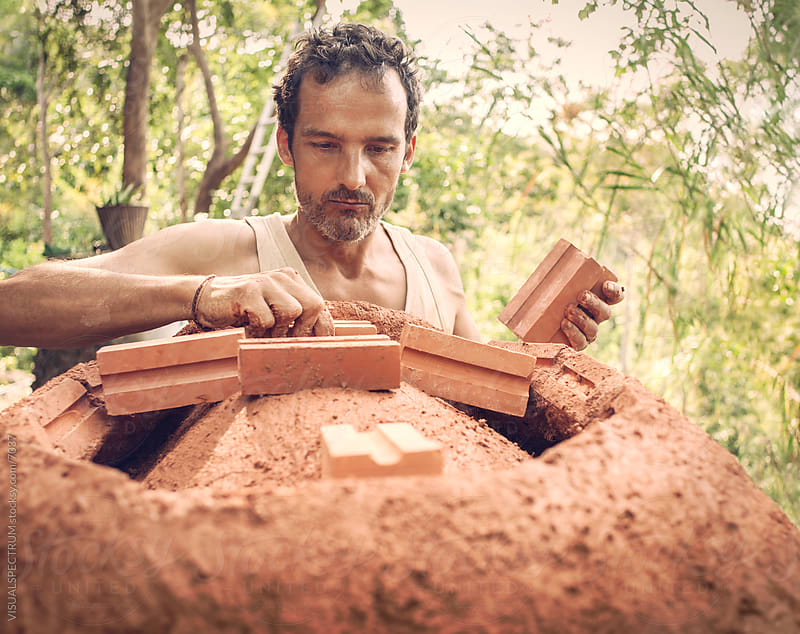 Natural Building - Caucasian Man Working with Earth Bricks by VISUALSPECTRUM for Stocksy United