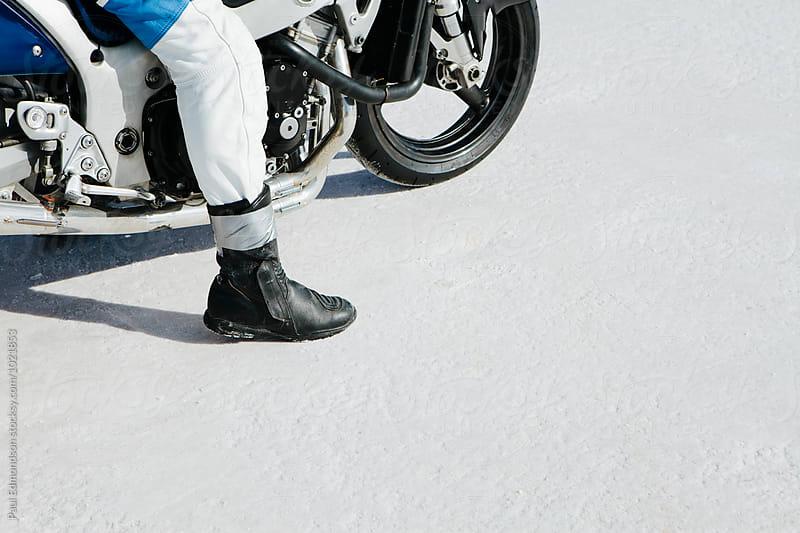 Detail of motorcyclist sitting on bike, waiting to race down playa, Bonneville Salt Flats, UT, USA by Paul Edmondson for Stocksy United