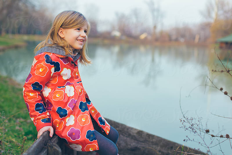 Girl Sitting by the River by Lumina for Stocksy United