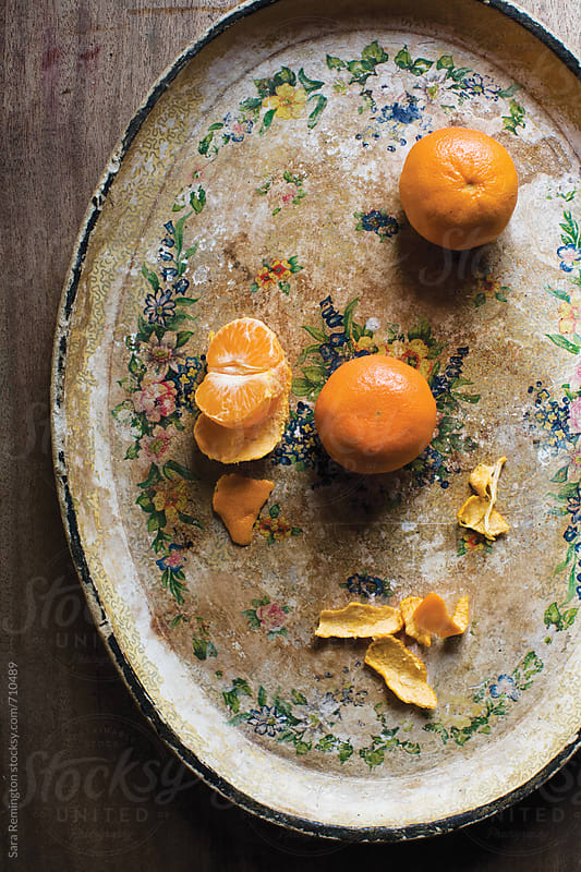 Peeled Clementines on Platter by Sara Remington for Stocksy United