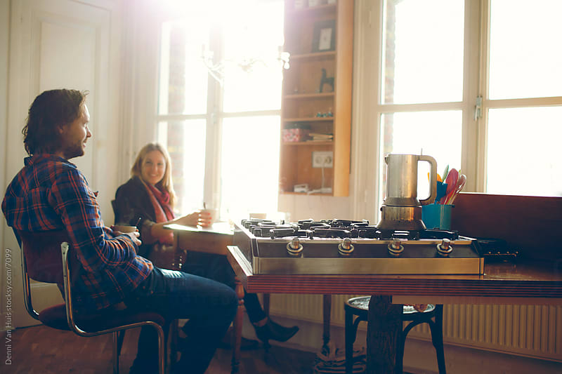 Two people enjoying a coffee by Denni Van Huis for Stocksy United