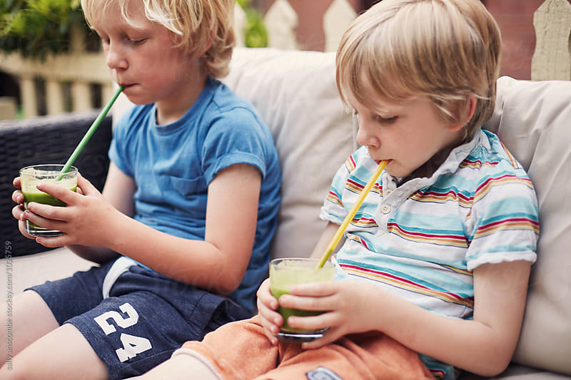 Children drinking green smoothies by sally anscombe for Stocksy United