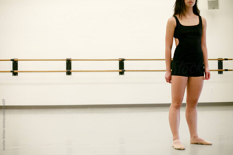 Young dancer standing in studio by Jennifer Brister for Stocksy United