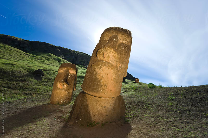 South America, Chile, Rapa Nui, Isla de Pascua (Easter Island), giant monolithic stone Maoi statues at Rano Raraku - illuminated and backlit by moonlight by Gavin Hellier for Stocksy United
