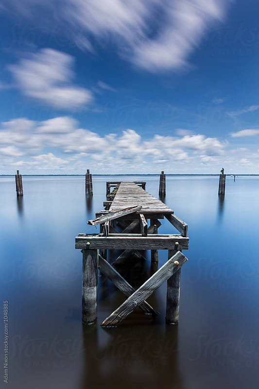 Abandoned Wooden Dock by Adam Nixon for Stocksy United