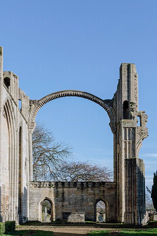 Arch of a ruined medieval Abbey.  by Paul Phillips for Stocksy United