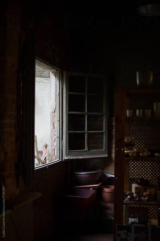 An open window of a garage by Lydia Cazorla for Stocksy United