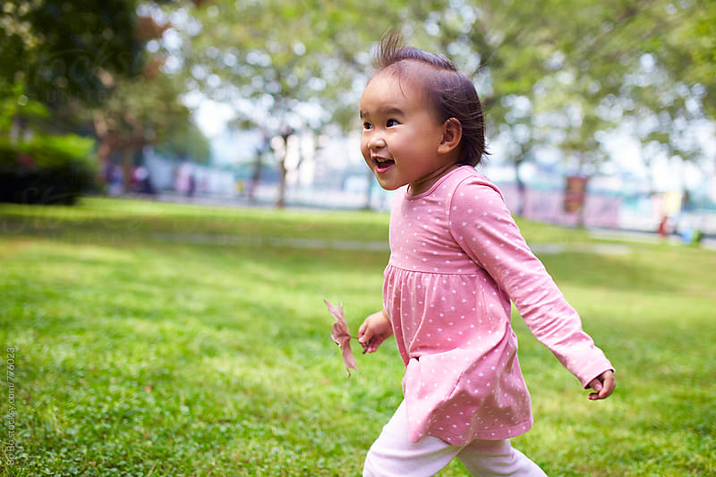 happy little girl running in the park by Bo Bo for Stocksy United