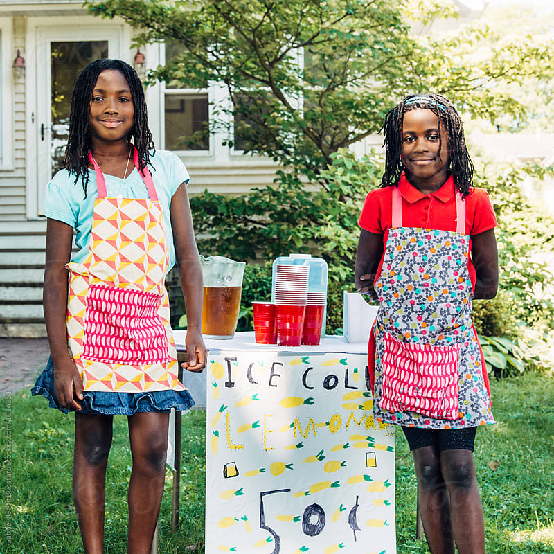 Two African American girls by a lemonade stand by Gabriel (Gabi) Bucataru for Stocksy United