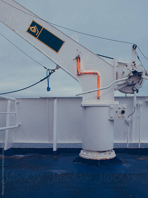 Crane on a ferry by Photographer Christian B for Stocksy United