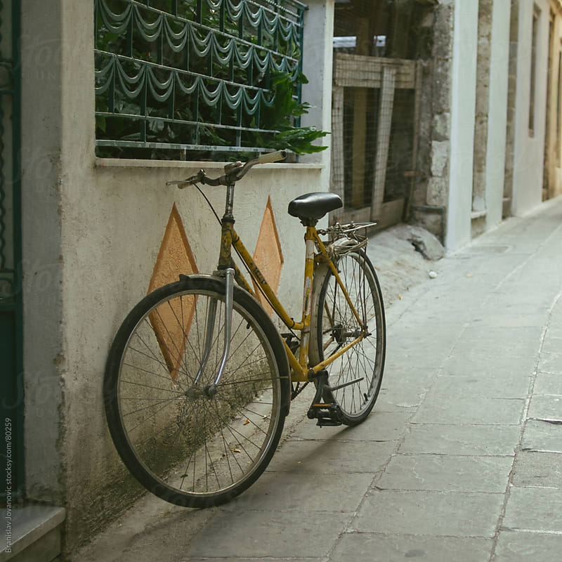 Old Bicycle On the Street by Branislav Jovanović for Stocksy United