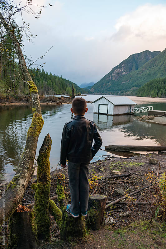 Boy Stands In What Could Only Be Termed A Classic Pacific Northwest Setting by Ronnie Comeau for Stocksy United