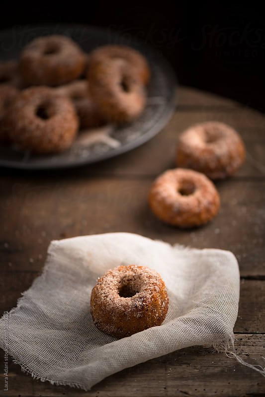 small donuts with apple and maple syrup by Laura Adani for Stocksy United