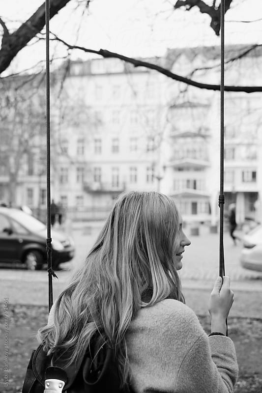 Woman at a swing by Lyuba Burakova for Stocksy United