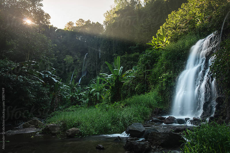 Hidden Paradise. Tropical Island Waterfall by Alexander Grabchilev for Stocksy United