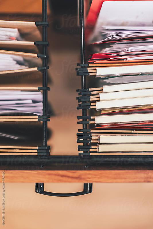 Detail of documents folders inside a folders drawer. by BONNINSTUDIO for Stocksy United