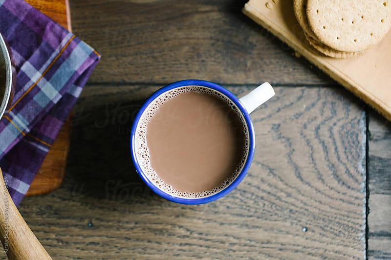 Enamel mug of hot chocolate overhead by Kirsty Begg for Stocksy United