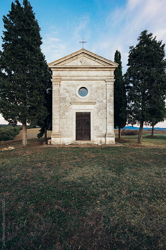 little white church with cypresses by Juri Pozzi for Stocksy United