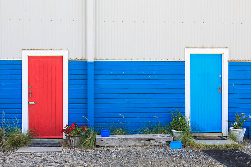 Red and blue door. Western Australia. by John White for Stocksy United