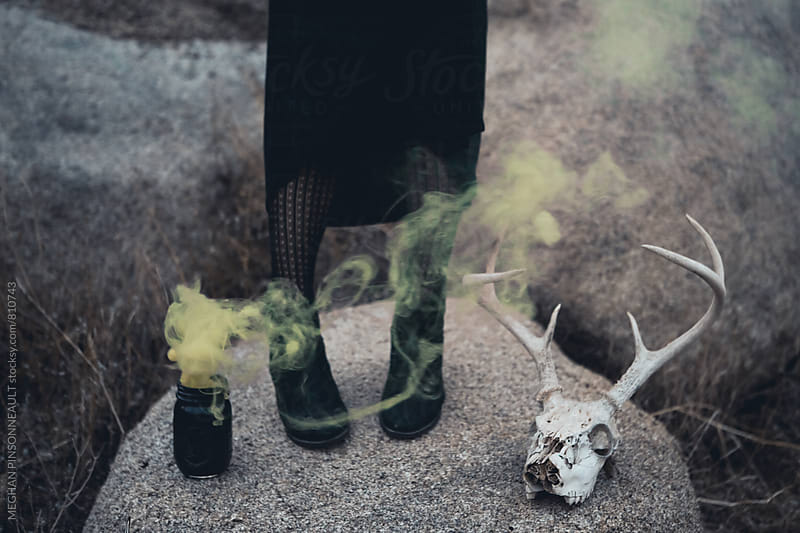 Witchy Feet with Yellow Smoke and Deer Skull by Meg Pinsonneault for Stocksy United