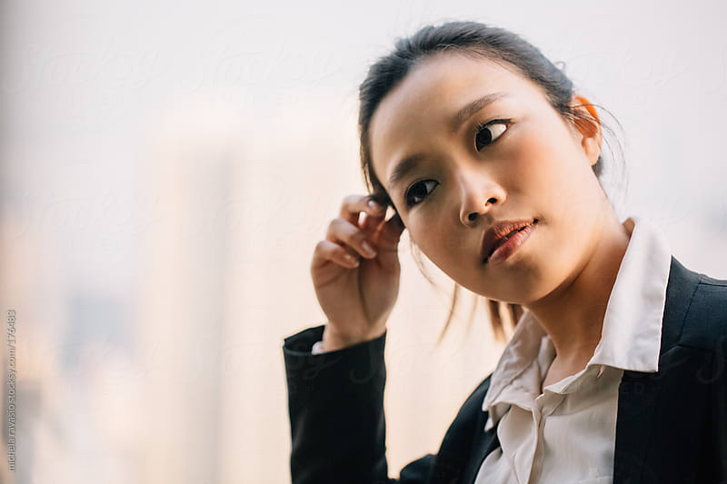 Portrait of a young beautiful asian woman  by michela ravasio for Stocksy United