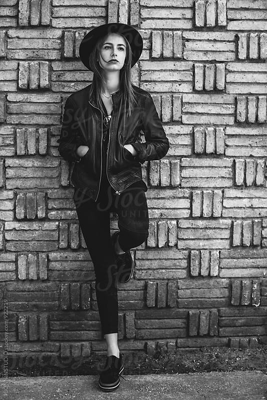 Portrait of an alternative woman standing in front of a wall. by BONNINSTUDIO for Stocksy United