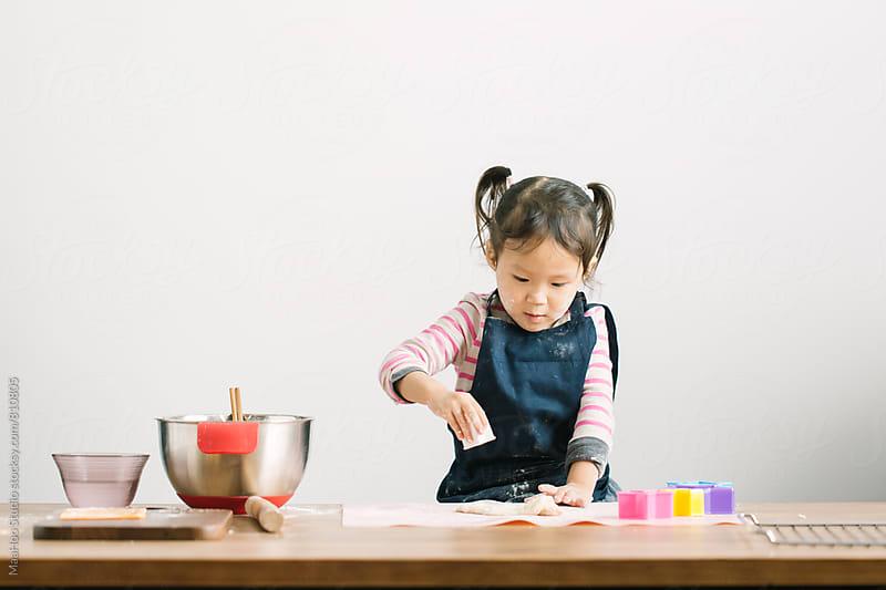 Toddler girl making cookies by MaaHoo Studio for Stocksy United
