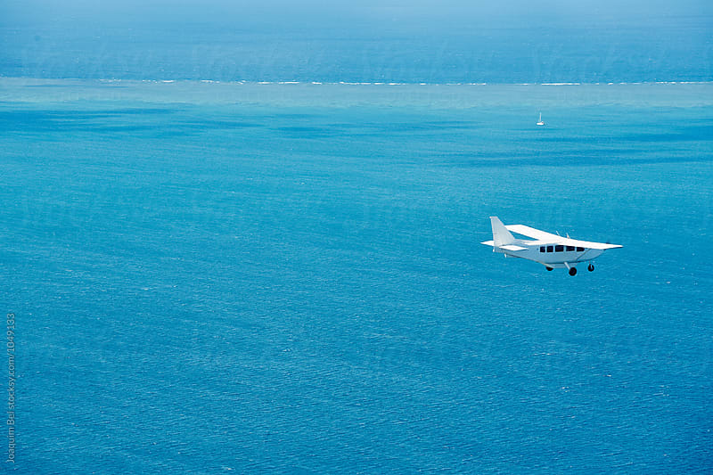 Airplane flying over the Great Barrier Reef by Joaquim Bel for Stocksy United