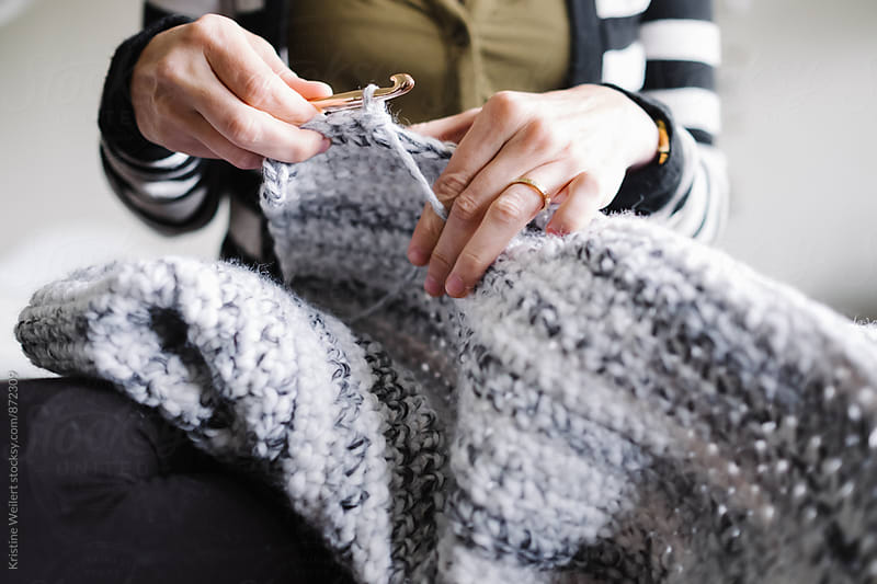 Womans hands crocheting a blanket by Kristine Weilert for Stocksy United