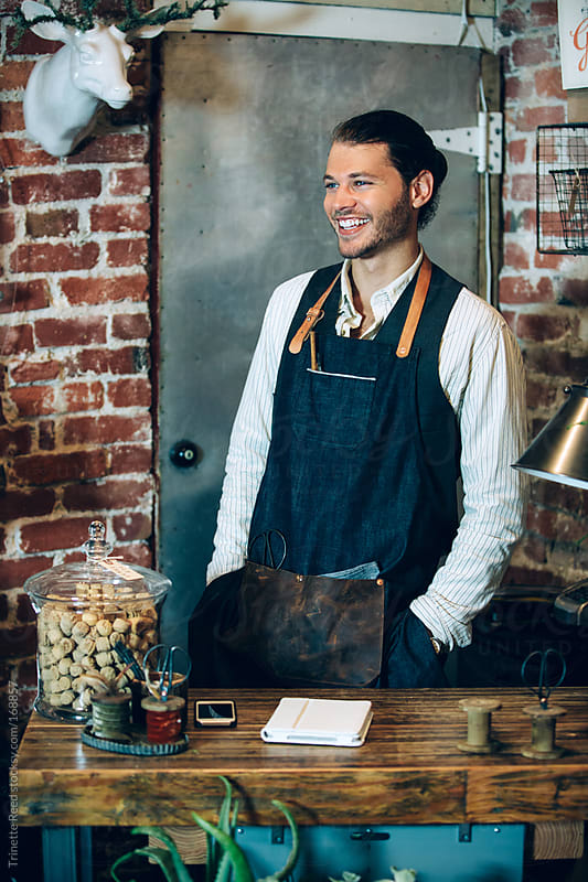 Business owner in small artisan shop by Trinette Reed for Stocksy United