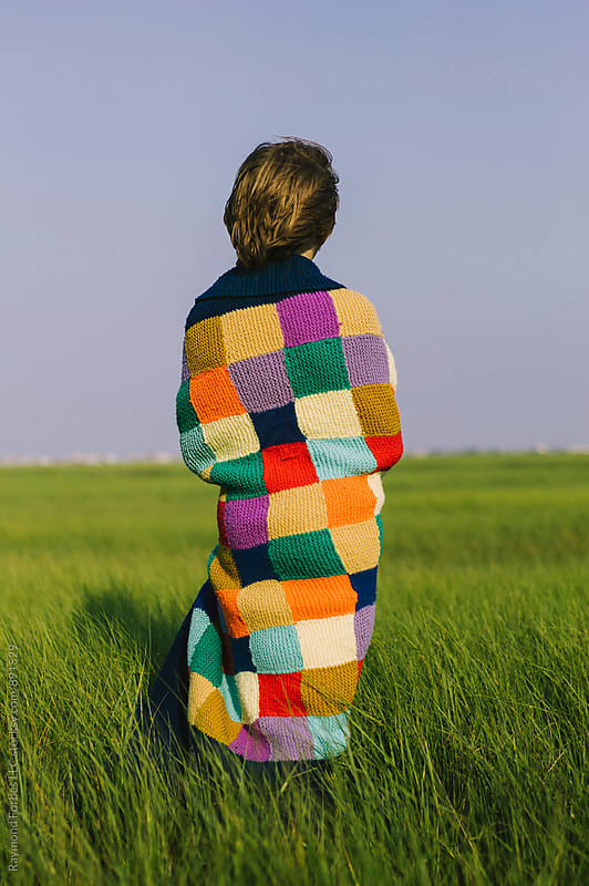 Boy With Blanket by Raymond Forbes LLC for Stocksy United