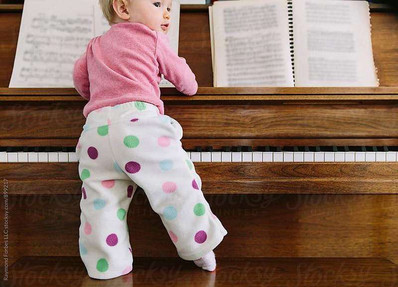 Toddler Playing at Piano by Raymond Forbes LLC for Stocksy United