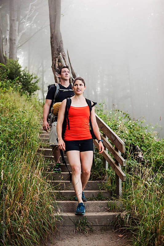 Hiking couple through the forest by Suprijono Suharjoto for Stocksy United