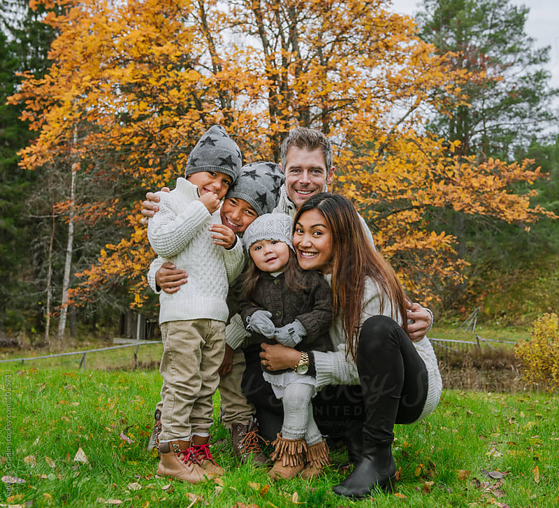happy autumn family by Andreas Gradin for Stocksy United
