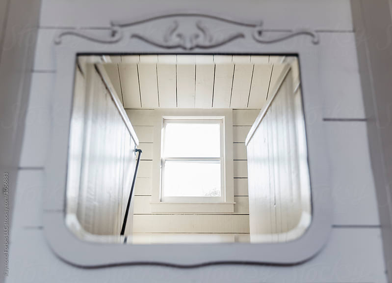 Window at the Top of the Stairs by Raymond Forbes LLC for Stocksy United