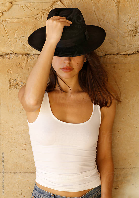 young woman with hat by Rene de Haan for Stocksy United