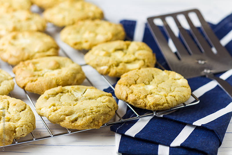 Cooking Rack of White Chocolate Cookies by Kirsty Begg for Stocksy United