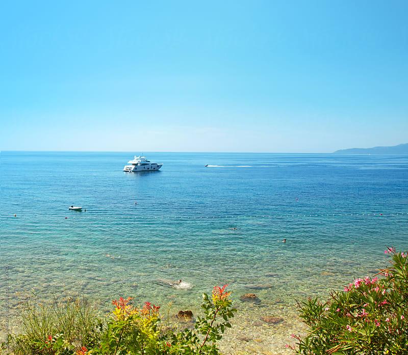 boat in the sea by Sonja Lekovic for Stocksy United