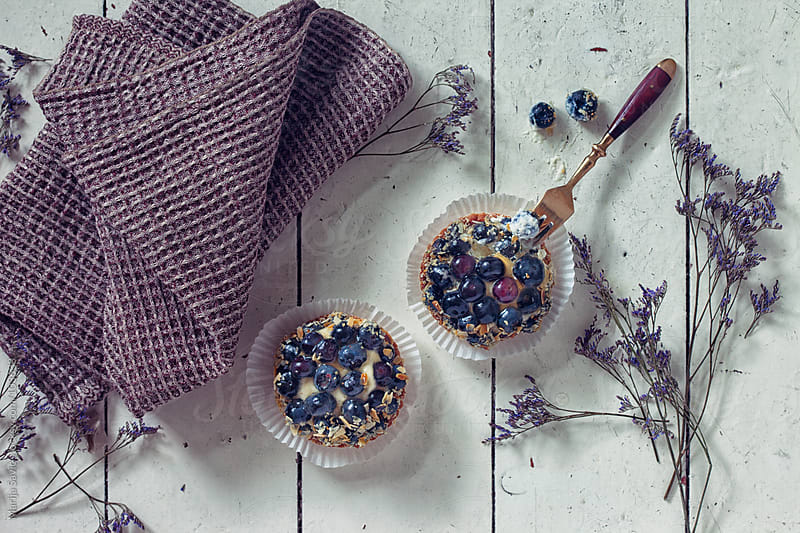Blueberry dessert served on a wooden table. by Marija Savic for Stocksy United