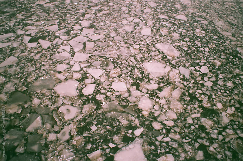 A film shot of river full of melting ice by Anna Malgina for Stocksy United
