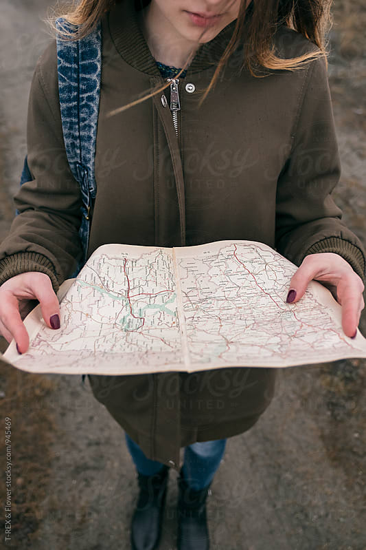 Close-up of traveler holding map by Danil Nevsky for Stocksy United