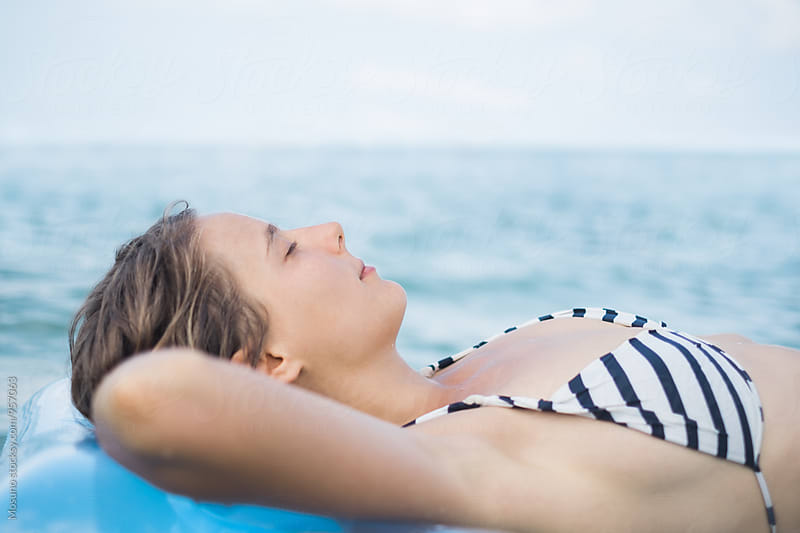 Woman Enjoying Sun in the Water by Mosuno for Stocksy United